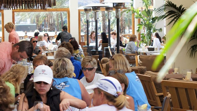 Guests take advantage of the wonderful outdoor dining at Tommy Bahama's, Palm Desert.
