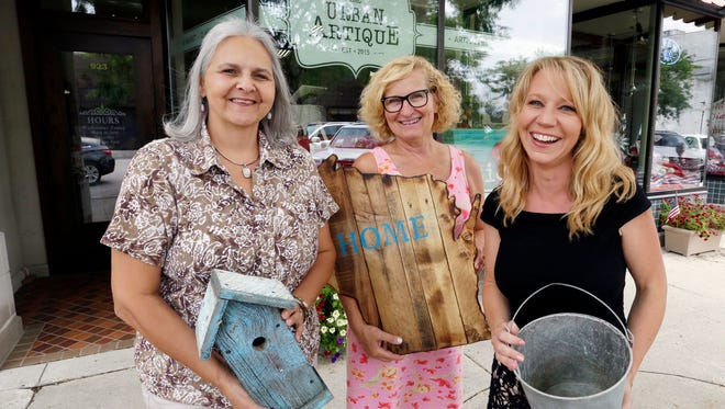 Urban Artique's, from left, Rose Wessel, Judi Knier and Kristin Bork pose outside of their 8th Street firm Friday July 29, 2016 i Sheboygan.