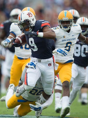 San Jose State safety Vincenté Miles, Jr. tackles Auburn running back Roc Thomas (9) during the NCAA football game between Auburn and San Jose State on Saturday, Oct. 3, 2015, at Jordan-Hare Stadium in Auburn, Ala. 