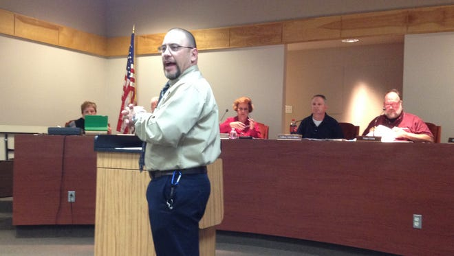 """Sixth Street Elementary Principal Louis Alvarez discusses the innovative literacy """"races"""" during Tuesday's school board meeting."""