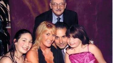 Richard Beltram with son Richard, daughter-in-law Christine and granddaughters Julia, left, and Daniella, right.