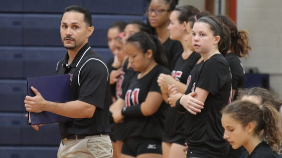 Nyack's volleyball coach Christian Collazo with his
