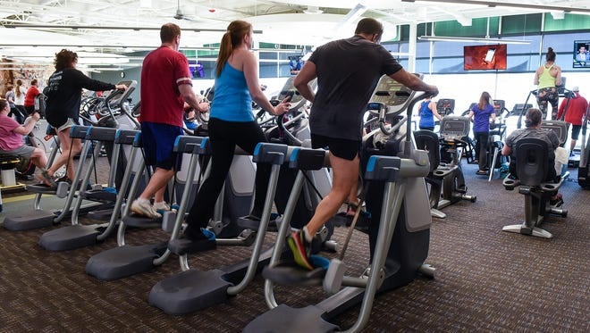 People exercise Tuesday, March 13, at the St. Cloud YMCA Community and Aquatic Center.