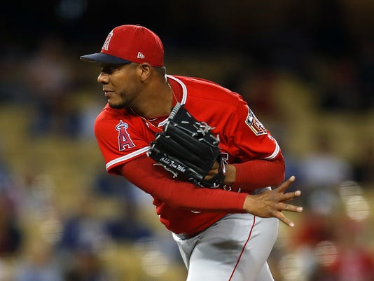 Los Angeles Angels starting pitcher JC Ramirez throws to a Los Angeles Dodgers batter during the first inning of an exhibition baseball game Tuesday, March 27, 2018, in Los Angeles. (AP Photo/Jae C. Hong)