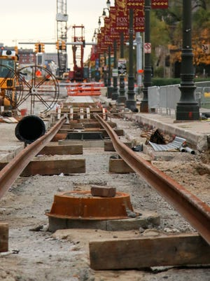 M-1 Rail line is being laid down Woodward Avenue in front of the Fox Theatre in downtown Detroit this month. Part of I-75 in Detroit is to close this weekend so construction crews can set bridge beams at Woodward.