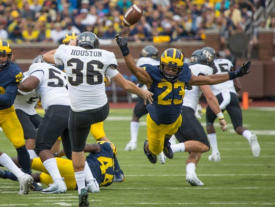 Michigan safety Tyree Kinnel attempts to block a punt