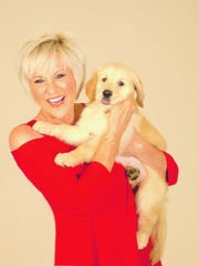 Lorna Luft, with one of the dogs she calls a hero.