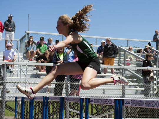 St. Johnsbury's Katherine Cowan leaps over a hurdle during the girls 100-meter hurdles at last year's Division I high school track and field state championships.