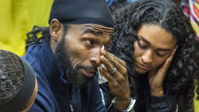 "Clinton ""C. J."" Jones, brother of Corey Jones, wipes his eyes after Nouman Raja was sentenced to 25 years in prison in West Palm Beach on April 25, 2019. Raja, a former Palm Beach Gardens police officer, was convicted on one count each of manslaughter by culpable negligence and first-degree attempted murder. He shot and killed stranded motorist Corey Jones Oct. 18, 2015.  [LANNIS WATERS/palmbeachpost.com] POOL"