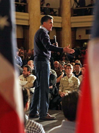 Republican presidential candidate, former Massachusetts Gov. Mitt Romney, joined by his wife Ann and sons during a campaign appearance at the Temple for the Performing Arts , Tuesday Jan. 3, 2012, in Des Moines, Iowa.