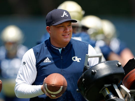 Georgia Tech head coach Geoff Collins works with his kick returners during the team's first preseason NCAA college football practice Wednesday, July 31, 2019, in Atlanta. From his love of Waffle House to the embracing of social media, the first-year coach has seemingly been everywhere since his hiring by the Yellow Jackets. Now, the reality: he's trying to install a new offense with the opener against reigning national champion Clemson about a month away.(AP Photo/John Bazemore)