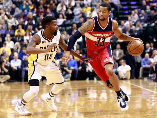 Washington Wizards guard Trey Burke (33) dribbles the basketball defended by Indiana Pacers guard Aaron Brooks in the first half of an NBA basketball game, Monday, Dec. 19, 2016, in Indianapolis. (AP Photo/R Brent Smith)