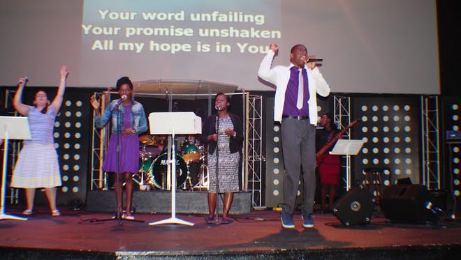 Youth leading the singing each night
