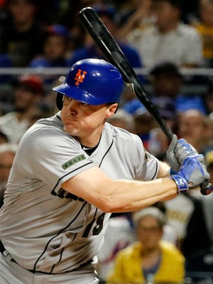 FILE - In this Sunday, May 28, 2017 file photo, New York Mets' Jay Bruce drives in two runs with a double off Pittsburgh Pirates starting pitcher Tyler Glasnow in the fifth inning of a baseball game in Pittsburgh. Two people familiar with the negotiations say free-agent outfielder Jay Bruce is set to return to the New York Mets after agreeing to a $39 million, three-year contract. The people spoke on condition of anonymity Wednesday, Jan. 10, 2018 because the deal is pending a physical and no announcement had been made.