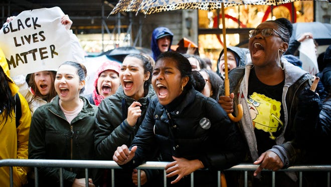 A group of high school students gather for a protest against  President-elect Donald Trump outside of Trump Tower, where Trump lives and has an office, in New York,  Nov. 15, 2016.