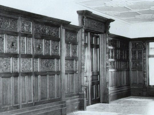 A wall of English red oak paneling once featured in