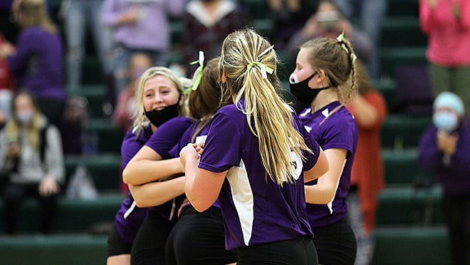 The Athens Indians celebrate their District title after the final point Thursday night versus Mendon.