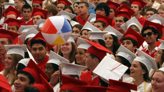 Fox Lane High School 2012 graduates have fun with a beach ball during their graduation ceremony at Caramoor in Katonah