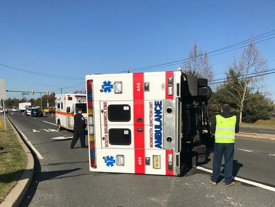 An ambulance flipped over on its side Tuesday in South