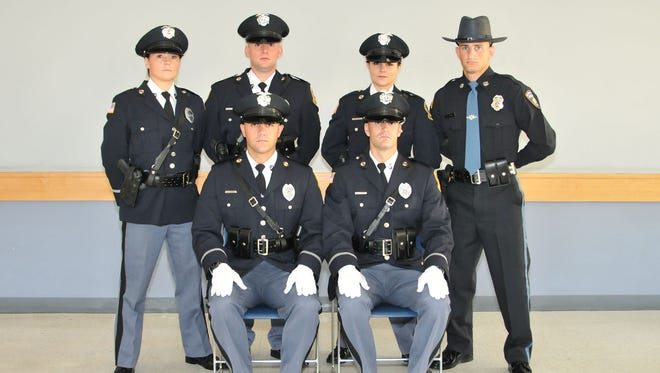 Worcester County law enforcement officers who graduated recently from the Eastern Shore Criminal Justice Academy are, front row, from left, James M. Bodine and Gary R. Cooper Jr. Back row, Tonya M. Gower, Kyle J. Hayes Jr., Julianne M. O'Toole and Evan C. Kolb.