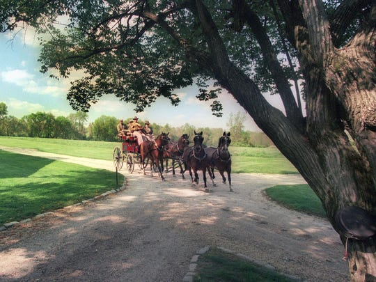"""George """"Frolic"""" Weymouth owned one of the best collections of horse carriages in the country. He was a founder of Point-to-Point's annual Parade of Carriages."""