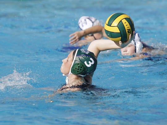 El Diamante's Makenzie Huskey takes a shot on goal against Redwood in a Central Section Division II championship water polo game in Visalia, Calif., Saturday, Nov. 19, 2016.