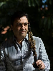 Professional clarinet soloist Julian Milkis Friday, Dec. 30, 2016 in his Naples home.