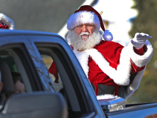 Santa arrives in Noblesville, the last ride in the Noblesville Christmas Parade, Sunday, Nov. 26, 2017.