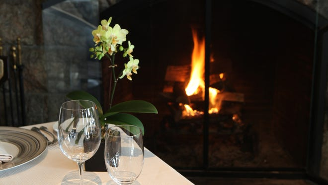 A view of one of the dining rooms and fireplace at Equus at the Castle Hotel and Spa in Tarrytown, photographed Feb. 6, 2014.  ( Joe Larese / The Journal News )