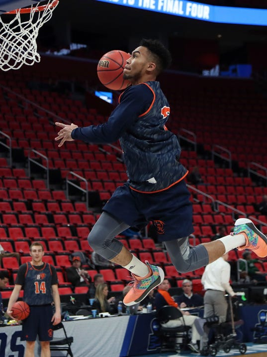 Bucknell guard Stephen Brown dunks during a practice session for an NCAA men's college basketball tournament first-round game, Thursday, March 15, 2018, in Detroit. Bucknell plays Michigan State in the first round on Friday. (AP Photo/Carlos Osorio)