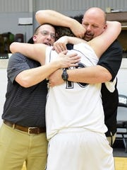 Luke Smith was embraced by his coaches following Tuesday