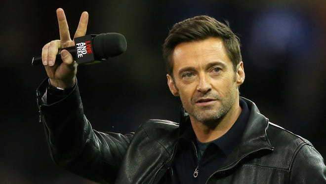 Hugh Jackman waves to the crowd during the round 23 AFL match between the Richmond Tigers and the North Melbourne Kangaroos at Etihad Stadium on Sept. 4, 2015, in Melbourne, Australia.