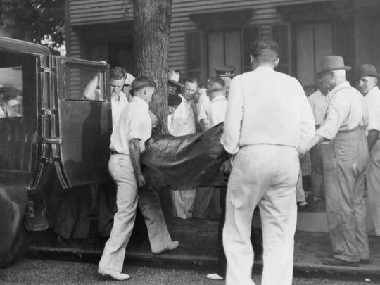 An Indianapolis News staff photo shows Dillinger's body being returned to Mooresville, Ind. in the wicker basket now on display in the John Dillinger Museum. The body was returned to Mooresville's Harvey Funeral Home from Chicago on July 24, 1934.