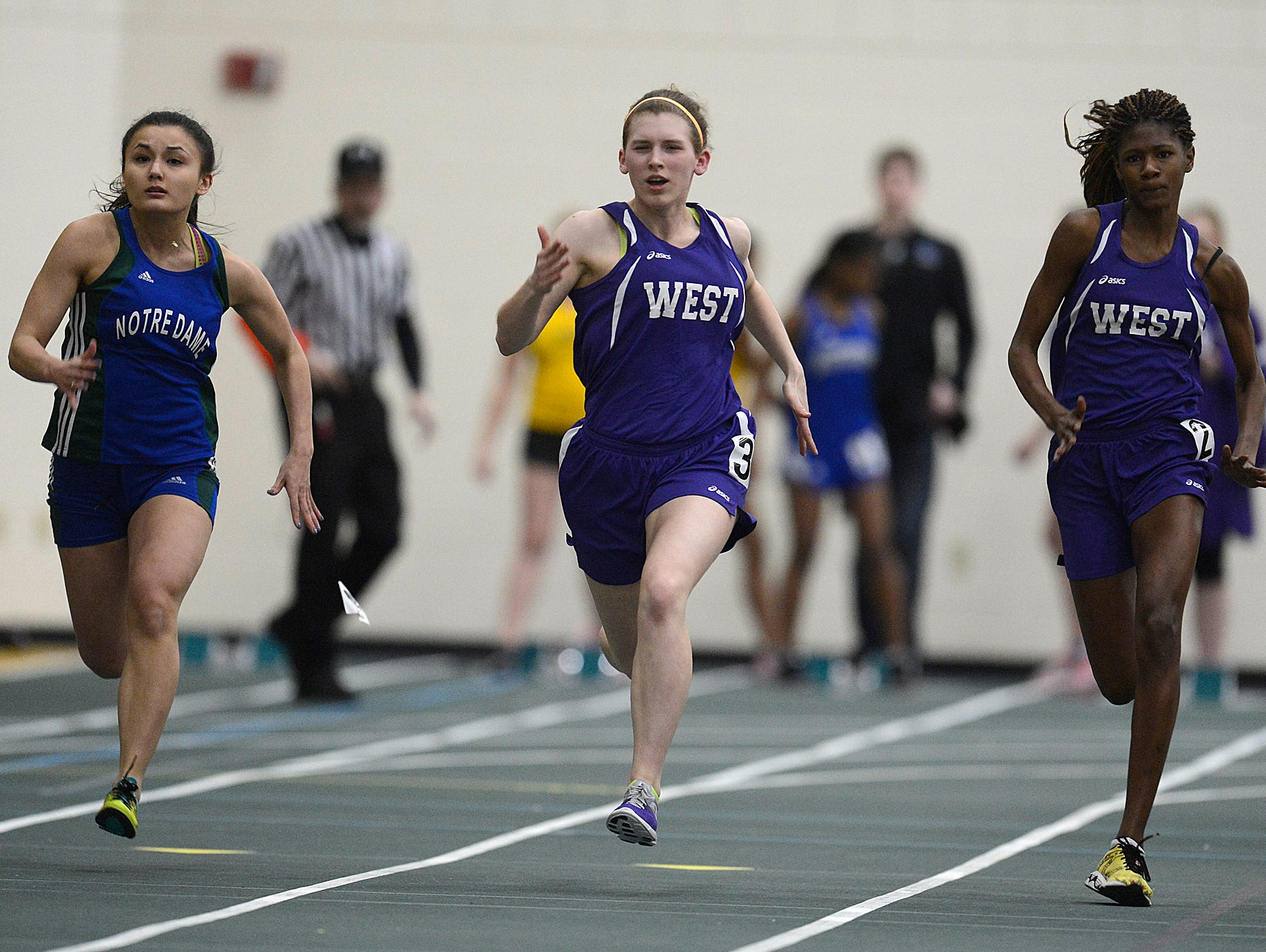 From left, Green Bay Notre Dame's Melaina Rapisarda, Green Bay West's Katelyn Leiden and Green Bay West's Maya Fisher compete in the 45 meter dash during the 16th annual Preble Indoor Invitational at Green Bay Preble High School on Wednesday, March 18, 2015.