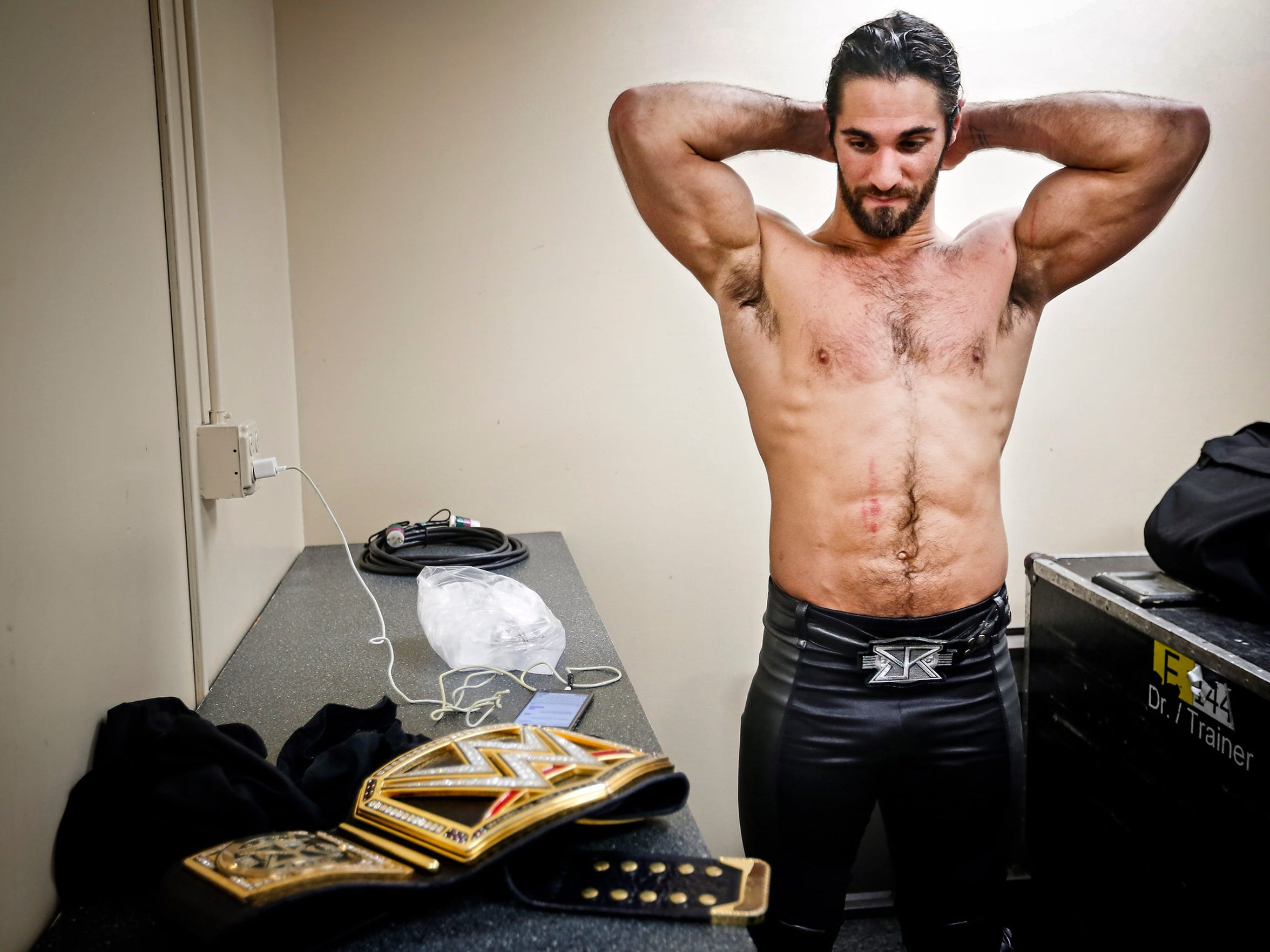 10:43PM: WWE Champion Seth Rollins cools down backstage