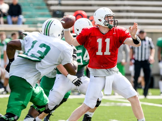 Marshall quarterback Michael Birdsong throws a pass during a spring intra-squad football game, Saturday, April 18, 2015 in Huntington, W.Va. (Sholten Singer/The Herald-Dispatch via AP)