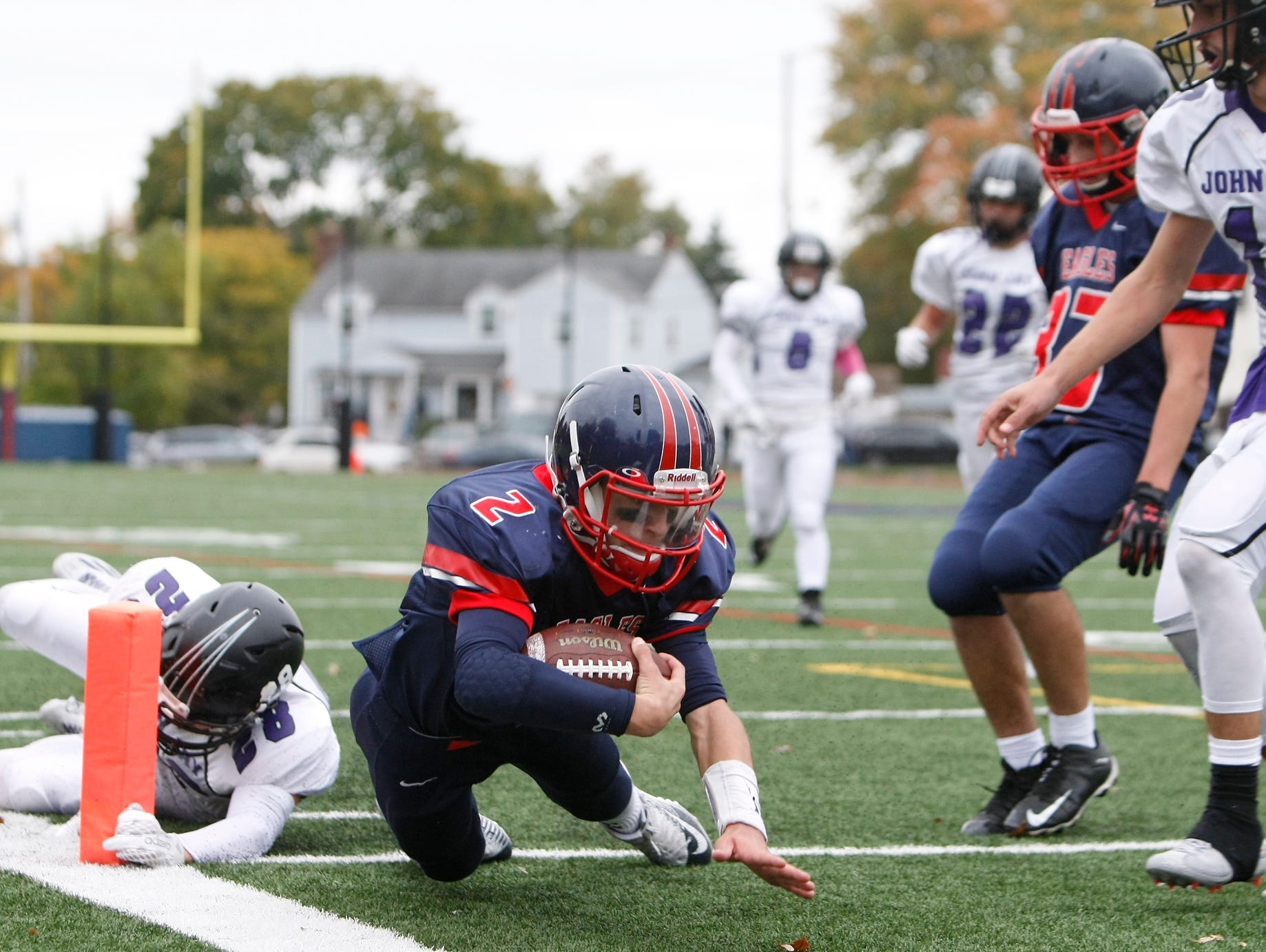 Eastchester quarterback John Arcidiacono (2) breaks the tackle of John Jay's Liam Tassone (28) for a touchdown during a varsity football game at Eastchester High School on Saturday, Oct. 24, 2015.