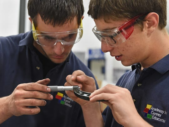 ACE charter high school students Jared Cuddy, left, and Joshua Nissim use a measure a cylinder bore in a diesel class at TMCC's Applied Technology Center. Both will graduate high school in June with a diesel certification.