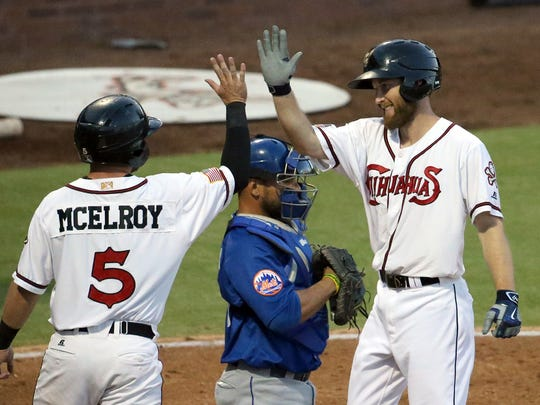 Rocky Gale, right, of the El Paso Chihuahuas, gets a high five from teammate Casey McElroy after Gale hit a two-run home run against the Las Vegas 51s in the bottom of the third inning Wednesday night at Southwest University Park.