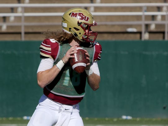 Midwestern State University's Layton Rabb looks to pass in the Maroon and Gold Spring Game Saturday, April 8, 2017, at Memorial Stadium.