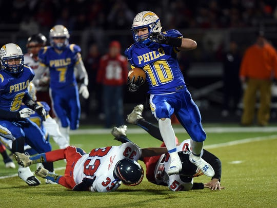 Philo's Cole Smith eludes a pair of Indian Valley defenders in last week's win. The Electrics face John Glenn on Friday with a final four berth at stake.