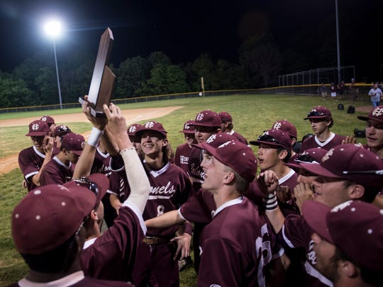 Henderson's team celebrates with their trophy during the district baseball final at Webster County High School on Thursday, May 24, 2018. Henderson County defeated Union County 11-0 in five innings.
