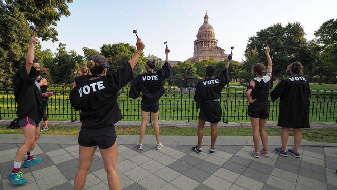 The Sisters With Blisters hoist tiny gavels high in front of the Capitol during a run Oct. 3 to honor Ruth Bader Ginsburg.