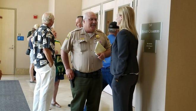 Sheriff Tom Bosenko speaks to District Attorney Stephanie Bridgett outside the Shasta County Board Chambers.