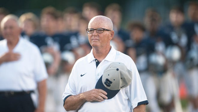 Shawnee High School's football coach Tim Gushue stands by his players during the national anthem prior to Friday night's football game between Shawnee and Washington Township played at Shawnee High School in Medford.  09.22.17