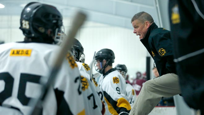 McQuaid head coach Al Vyverberg talks to the team while playing Auburn in the first period at Thomas Creek Ice Arena.