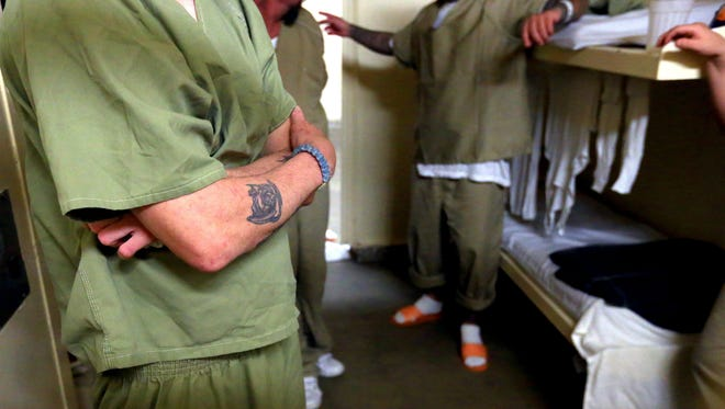 Male inmates talk to Sheriff Jim Kaelin in a cell Thursday, March 3, 2016 at the Nueces County Sheriff's Office in Corpus Christi. The jail recently failed an inspection and federal inmates are being pulled from the jail.