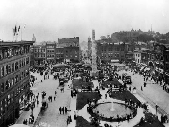 Pack Square looking west down Patton Avenue in 1913. Fountain and Vance Monument at center.