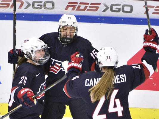 Anne Schleper of the U.S. celebrates her 4-1 goal with Hannah Brandt and Danielle Cameranesi during the 2015 IIHF Ice Hockey Women's World Championship gold medal match in Malmo
