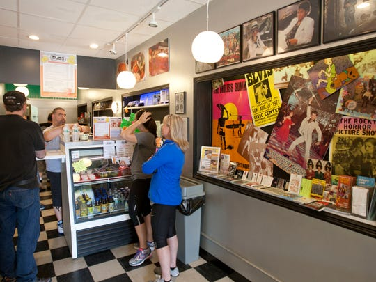 Eddy Sousa, co-owner of Vintage Subs in Asbury Park, prepares subs for his customers.